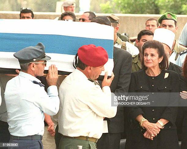 Widow of late Israeli Prime Minister Yitzhak Rabin, Leah Rabin, cries while looking at six Israeli generals carrying the coffin of her assassinated...