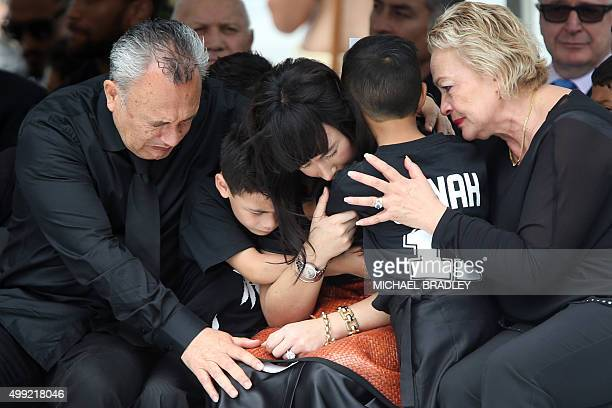 Widow of late New Zealand All Blacks rugby legend Jonah Lomu Nadene Lomu is comforted by her two sons Brayley and Dhyreille and her mother Lois Kuiek...