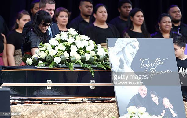 Widow of late New Zealand All Blacks rugby legend Jonah Lomu Nadene Lomu walks past his casket during a memorial service at Eden Park in Auckland on...
