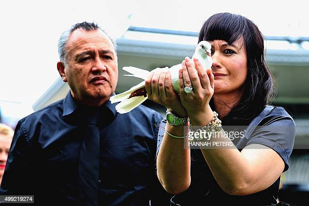 Widow of New Zealand All Blacks rugby legend Jonah Lomu Nadene Lomu releases a dove at New Zealand's home of rugby Eden Park during a memorial...