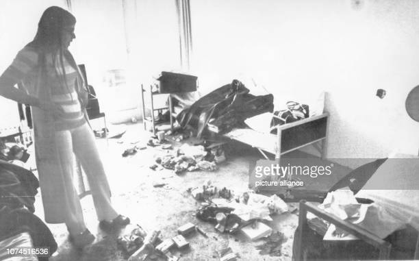 Widow of the killed fencing coach Andre Spitzer has a look at the completely destroyed room in the Olympic Village in Munich on 9 September 1972, in...