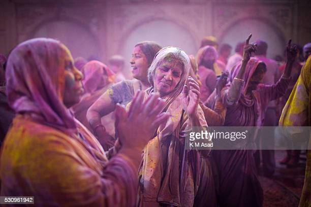 VRINDABAN UP VRINDABAN UP INDIA Widow plays with colored powder and dances as she takes part in a celebration of Holi or 'festival of colors' at the...