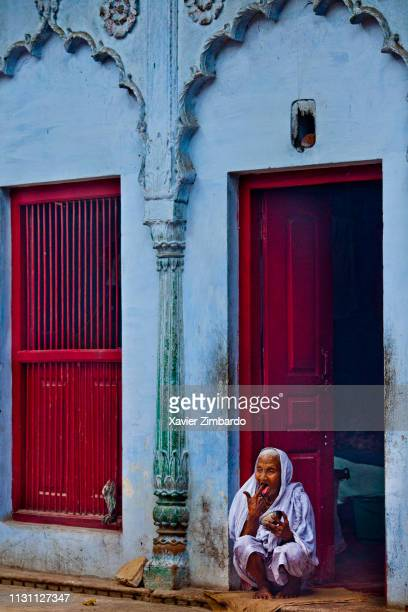 A widow sits in the door of her room and eats from bowl at Meera Sehbhagini Mahila Ashray Sadan In Vrindavan in the north Indian state of Uttar...