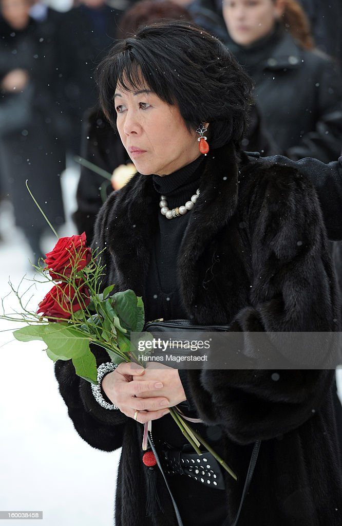 Widow Soo Leng-Kuchenreuther attends the memorial service for her husband Steffen Kuchenreuther at the Waldfriedhof on January 25, 2013 in Munich, Germany.