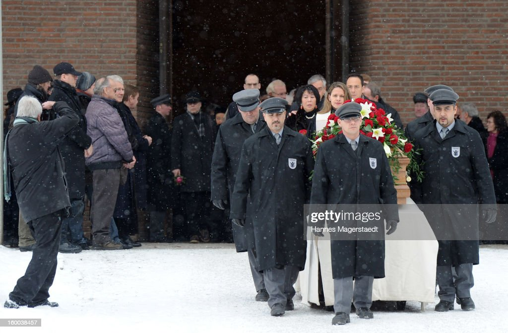 Widow Soo Leng-Kuchenreuther walks behind the coffin at the memorial service for her husband Steffen Kuchenreuther at the Waldfriedhof on January 25, 2013 in Munich, Germany.