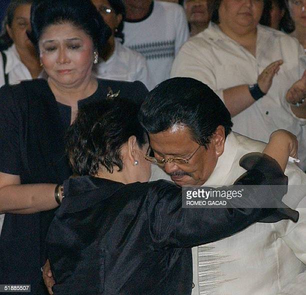 Widow Susan Roces is comforted by jailed former president Joseph Estrada while former first lady Imelda Marcos looks on as relatives and friends paid...
