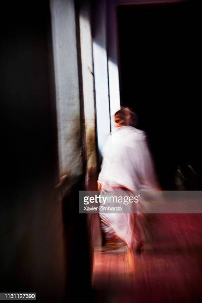 A widow walks in the corridor of Meera Sehbhagini Mahila Ashray Sadan In Vrindavan in the north Indian state of Uttar Pradesh on March 29 2013 in...