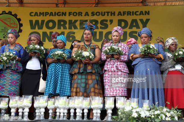 Widows and family members of the 34 slain miners gather to observe the sixth anniversary of the Marikana massacre on August 16, 2018 in Rustenburg,...