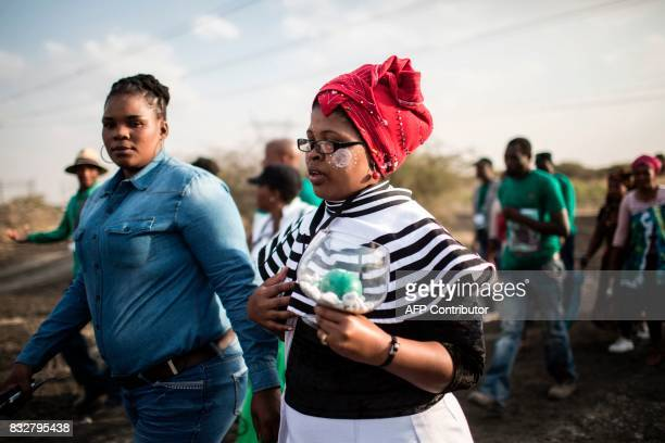 Widows of deceased striking miners who were killed during the Marikana massacre walk from the memorial site during the event's fifth anniversary in...