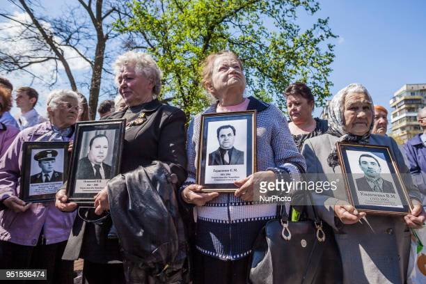 Widows of liquidators and firemen in the Chernobyl accident with photos of their husbands during the celebrations in Kiev of the 32nd anniversary of...