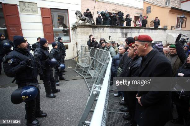 Widows of the soldiers of the Croatia's War of Independence and war veterans face police officers who block the St Mark's Square in central Zagreb on...
