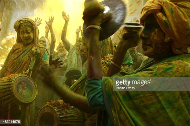 Widows throwing the 'Gulal' together enjoying the festival of colors 'Holi' on Wednessday at century old 'Pagal Baba Ashram' in Vrindavan