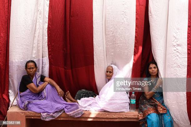 Widows watch the remarriage ceremony of Vinita Devi a widow got remarried with Rakesh Kumar at Gopinath Temple on October 16 2017 in Vrindavan India...