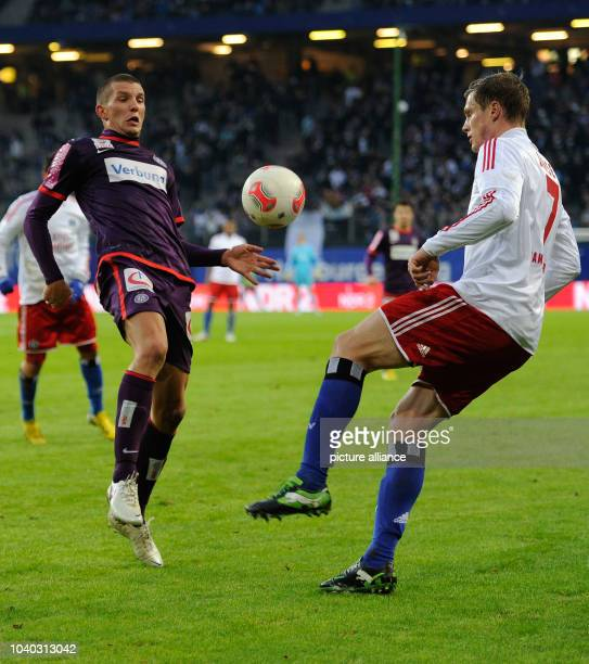 Wiens' Alexander Gorgon and Hamburgs' Marcell Jansen vie for the ball during the tryout match Hamburger SV FK Austria Wien in the ImtechArena in...