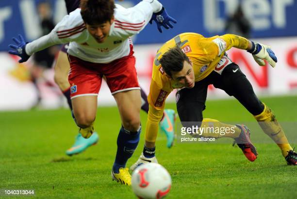 Wiens' keeper Heinz Lindner and Hamburgs' Heung Min Son vie for the ball during the tryout match Hamburger SV FK Austria Wien in the ImtechArena in...
