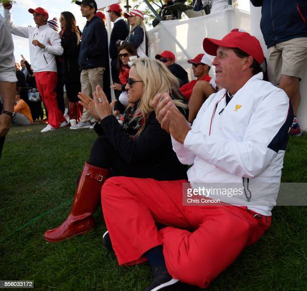 wife Amy Mickelson and Phil Mickelson of the US Team watch the action during the afternoon fourball matches at the Presidents Cup at Liberty National...