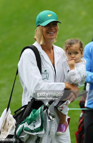 Wife Angie and daughter Dakota of Bubba Watson of the United States walk during the Par 3 Contest prior to the start of the 2017 Masters Tournament...