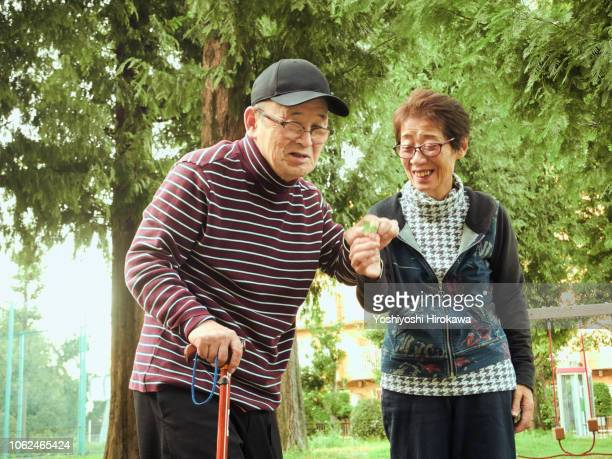 wife assisted living at home with wheelchair - 80代 ストックフォトと画像