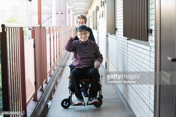 wife assisted living at home with wheelchair - doing a favor stock pictures, royalty-free photos & images
