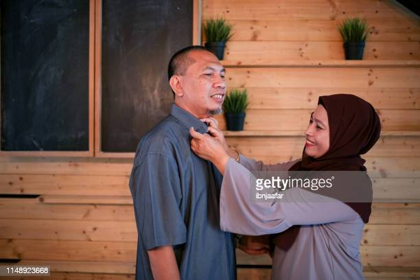 wife button down husband shirt - eid al adha stock pictures, royalty-free photos & images