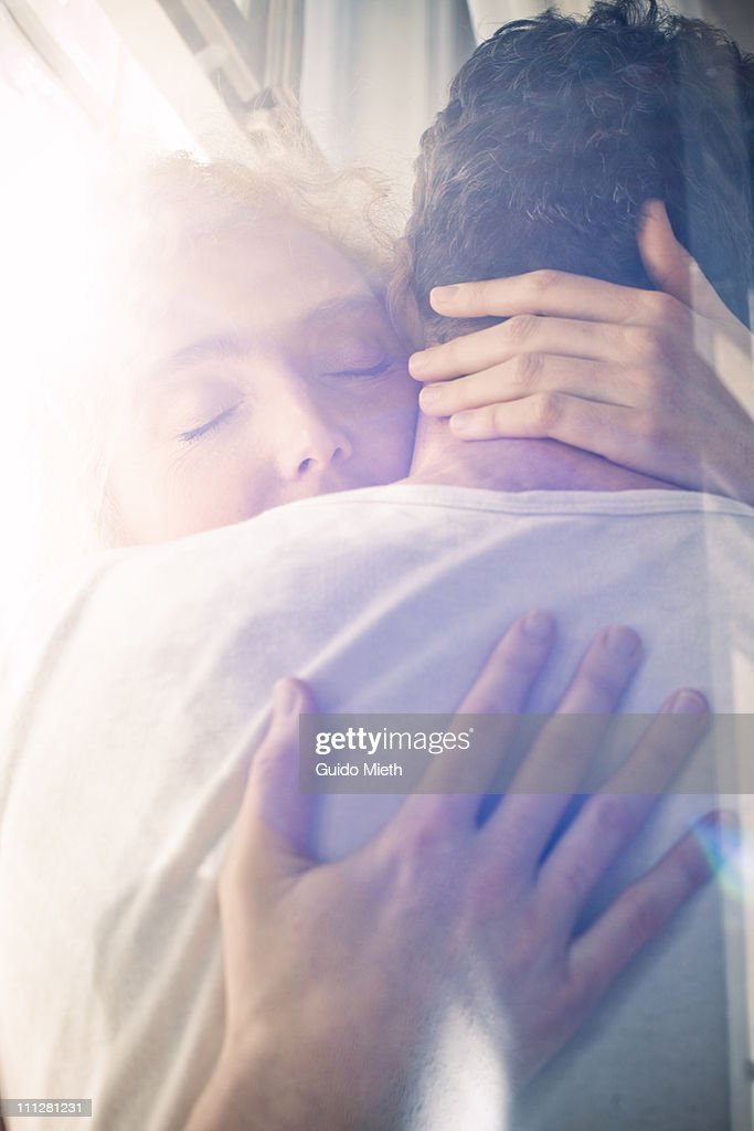 wife holdig her husband tightly : Stock Photo