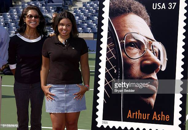 Wife Jeannie and daughter Camren of Arthur Ashe pose during the unveiling of the new stamp dedicated to arthur during Arthur Ashe day at the US Open...