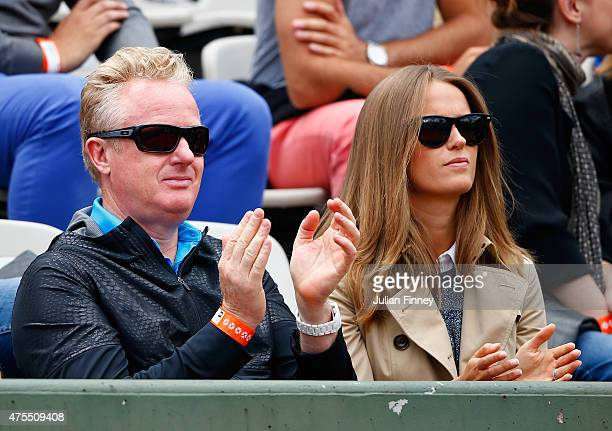 Wife Kim Murray and and Physio Mark Bender watch Andy Murray of Great Britain in his Men's Singles match against Jeremy Chardy of France on day nine...