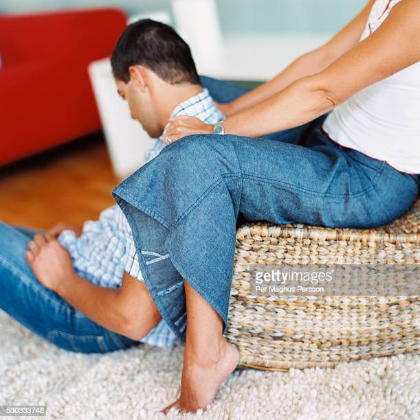 wife massaging husbands' shoulders - husband massage wife stock photos and pictures