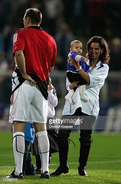 Wife Michaela Nowotny holds her daughter Lilly on her arm and Jens Nowotny says goodbye after the friendly match between Mein Sommermaerchen and KSC...