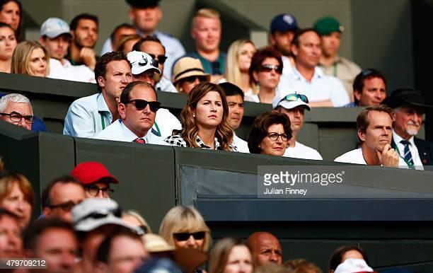 Wife Mirka Federer and Coach Stefan Edberg watch Roger Federer of Switzerland in his Gentlemen's Singles Fourth Round match against Roberto Bautista...