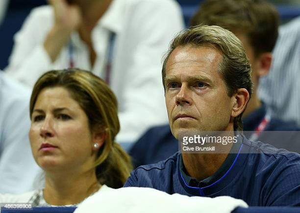 Wife Mirka Federer and coach Stefan Edberg watch Roger Federer of Switzerland play Steve Darcis of Belgium during their Men's Singles Second Round...