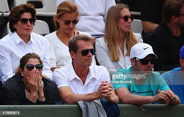 Wife Mirka Federer coach Stefan Edberg and Severin Luthi watch Roger Federer of Switzerland during his Men's quarter final match against Stanislas...