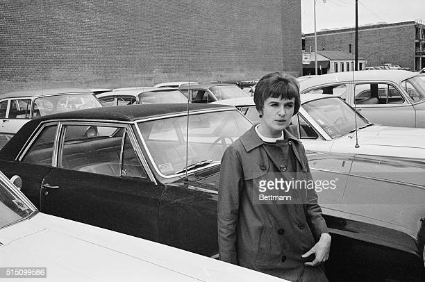 Wife of accused assassin Lee Oswald Marina Oswald walks through a parking lot after leaving the federal building where she gave the her deposition