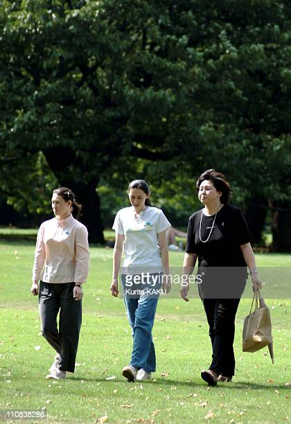 Wife Of Accused Us Army Deserter Charles Jenkins Hitomi Soga And Children Strolling In Tokyo Japan On July 23 2004 Wife of accused US army deserter...