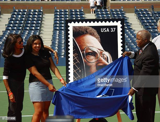 Wife of Arthur Ashe Jeannie Ashe daughter of Arthur Ashe Camren Ashe and Vice President of the Postal service Henry Pankey at the Arthur Ashe...