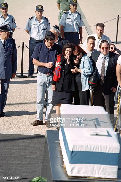 Wife of assassinated Israeli Prime Minister Yitzhak Rabin, Leah Rabin , is comforted by relatives in front her husband's coffin on November 5 outside...