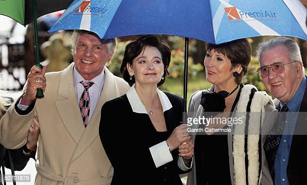 Wife of British Prime Minister Tony Blair Cherie Blair and unidentified guests attend the funeral service held for actor Sir John Mills on April 27...