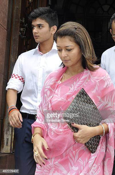 Wife of Congress MP Jyotiraditya Scindia Priyadarshini Raje Scindia with her son Aryaman Scindia come out after visiting Parliament house on July 16...