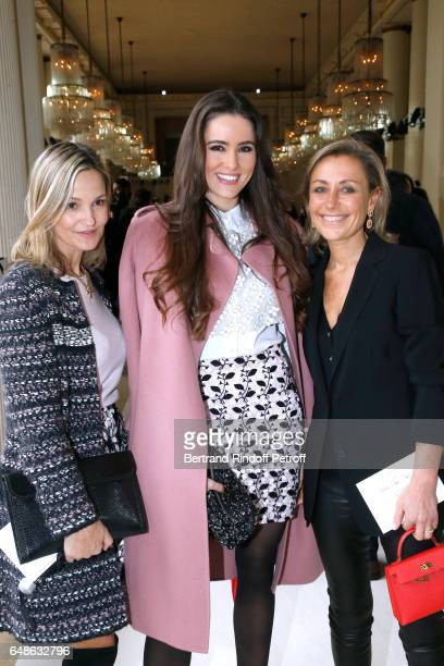 Wife of Doctor Frederic Saldmann Marie Saldmann Celia Jaunat and guest attend the Giambattista Valli show as part of the Paris Fashion Week...