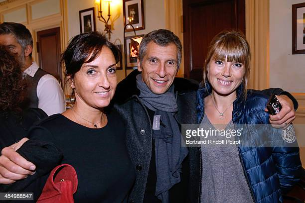 Wife of Francois Xavier Emmanuelle Demaison TV presenter Nagui and actress Melanie Page attend the FrançoisXavier Demaison show 'Demaison S'Evade'...