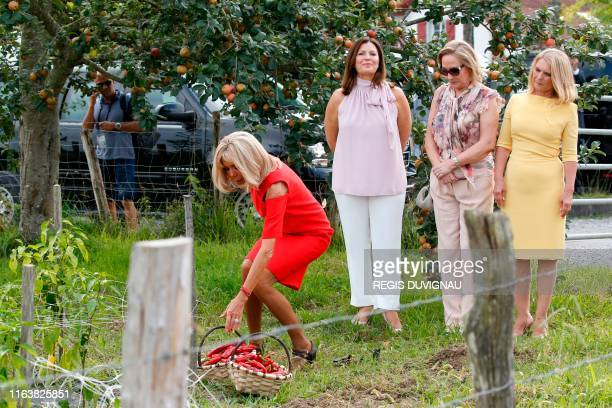 Wife of French President Brigitte Macron followed by Australia's Prime Minister's wife Jenny Morrison Chile's First Lady Cecilia Morel and European...
