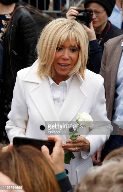 Wife of French President Emmanuel Macron, Brigitte Macron leaves the polling station after casting her vote in the European elections on May 26, 2019...