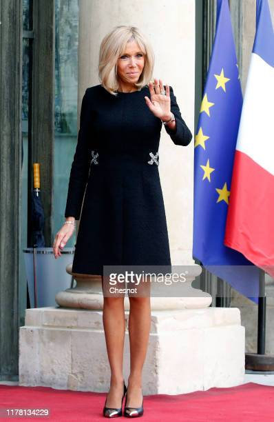 Wife of French President Emmanuel Macron Brigitte Macron waits for guests prior to a lunch at the Elysee Presidential Palace on September 30 2019 in...