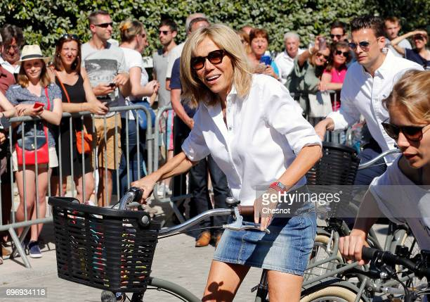 Wife of French President Emmanuel Macron Brigitte Trogneux leaves her home on a bicycle on the eve of the second round of the French parliamentary...