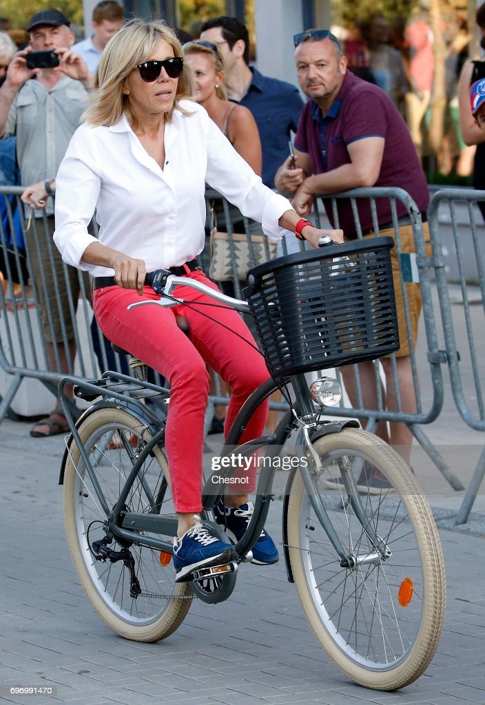 Wife of French President Emmanuel Macron, Brigitte Trogneux leaves her home on a bicycle the eve of the second round of the French parliamentary elections on June 17, 2017 in Le Touquet-Paris-Plage, France. The second round of the French legislative elections will take place on June 18, 2017.