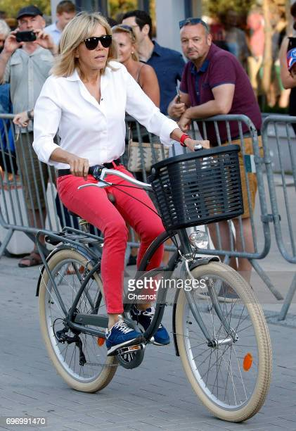Wife of French President Emmanuel Macron Brigitte Trogneux leaves her home on a bicycle the eve of the second round of the French parliamentary...