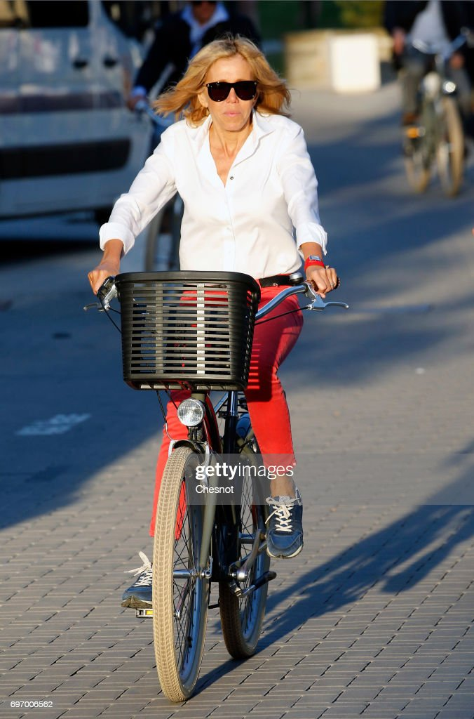 Wife of French President Emmanuel Macron, Brigitte Trogneux returns to her home on a bicycle the eve of the second round of the French parliamentary elections on June 17, 2017 in Le Touquet-Paris-Plage, France. The second round of the French legislative elections will take place on June 18, 2017.