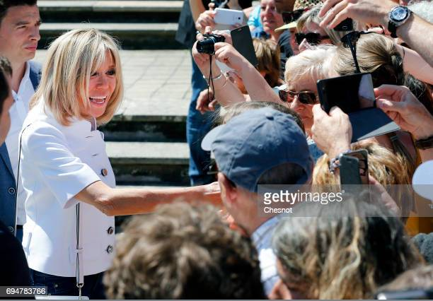 Wife of French President Emmanuel Macron Brigitte Trogneux shakes hands with the public as she leaves the polling station of the town hall after...