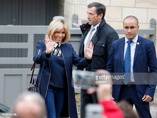 Wife of French presidential election candidate for the 'En Marche!' political movement, Emmanuel Macron, Brigitte Trogneux leaves her home prior her...