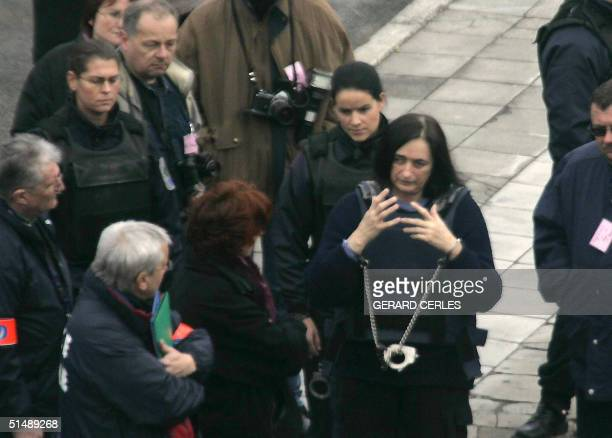 Wife of French selfconfessed serial killer Michel Fourniret Monique Olivier speaks to magistrates during a reenactment of Elisabeth Brichet's...